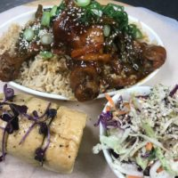 ASIAN INFUSED CHICKEN with garlic bread and Asian coleslaw
